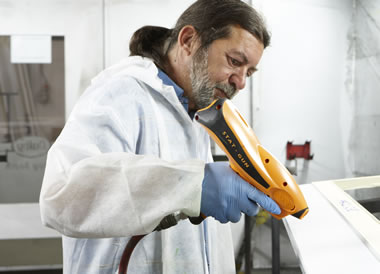 A paint technician spraying some profile