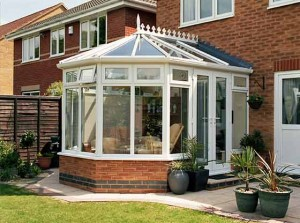 PVCu Victorian conservatory with Synseal Global roof